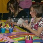 Young girl using felts that are included in our Crafts Workshop Hire