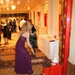 Glamorous women on the Test of Strength during an awards evening