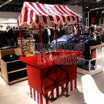 One of our Traditional Wooden Cart installed inside of a clothing store