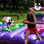 young girl racing through the Assault Course Tyres