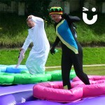 women dressed as cool runnings on the Assault Course Tyres