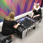 two Fun Experts playin on the Atari Pong Table Hire during their break at the office