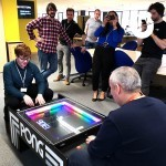 Our Atari Pong Table Hire bringing in the crowds wanting to take pictures of it in use in their offices