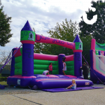 Young adults playing on the adult bouncy castle hire