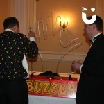 Two men trying out our Hand Buzz wire Hire during a corporate awards evening
