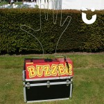 Our Hand Buzz wire Hire in red on display outside