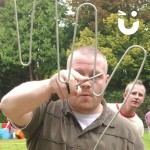 A man carefully concentrating on guiding the wand through the Hand Buzz wire Hire