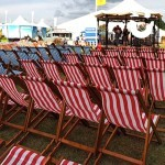 Deckchairs setup in front of a band stand