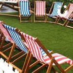 The Deckchair Hire in a semi circle for an outdoor corporate fun day