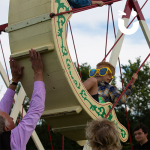 Children At A Fun Day On A Festival Ride