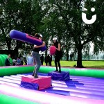Two girls competing on the Gladiator Joust Hire