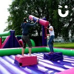 Two contenders in the sun at the Gladiator Joust Hire during a family fun day