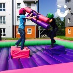 Two students wresting for victory on the Gladiator Joust Hire