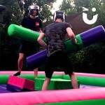 Two adults on the Gladiator Joust