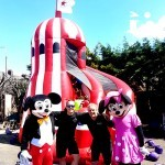 Mickey, Minny and some Fun Experts in front of the Helter Skelter Slide Hire