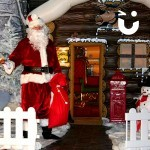 Santa welcoming guests into the Inflatable Santa's Grotto