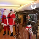 Mr and Mr's claus by the Inflatable Santa's Grotto