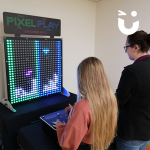Two girls competing on the Pixel Play Hire
