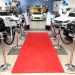 The Red Carpet And Stancions 4m Hire inside a car show room