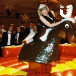 A women trying to stay on the Rodeo Reindeer Hire