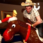 Man trying his hardest to stay on the Rodeo Reindeer Hire