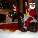Santa Clause sitting on the Rodeo Reindeer Hire