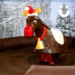 The Rodeo Reindeer Hire waiting for its next contender with xmas backdrop hire