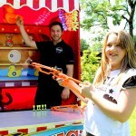 One of our Fun Experts with a young girl on the Target Stall Hire