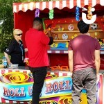 Two teenagers having a go on the Target Stall Hire