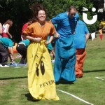 man and women on the sack race during a sports day