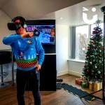 A guest fully embraces Christmas - with Sonic The Hedgehog Christmas jumper - and enjoys the challenge of the Virtual Reality hire for his office Christmas Party