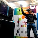 A guest interacts with the Virtual Reality on hire from Sunshine Events and in use as part of a promotional launch at an exhibition.
