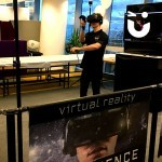 Fun Expert Ben straps on the HTC Vive VR headset to show guests how to interact with the VR experience