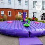 The Wipeout on hire for a student event, taking centre stage. The inflatable challenge is ready for guests to take on the sweeper arms