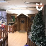 A view of Santa's Wooden Grotto through the trees
