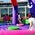 Close up of party guests having fun on The Inflatable Wrecking Ball available for hire from Sunshine Events