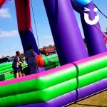 Children playing on the Inflatable Wrecking Ball at a family fun day in the North West