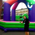 Fun Expert Alpas posing next to our Inflatable Wrecking Ball at a University event