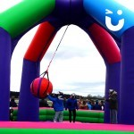 The Wrecking Ball Inflatable on hire at a family fun day entertaining guests