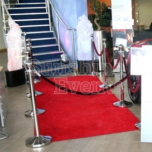 Red rope, balustrades and carpet for car launch