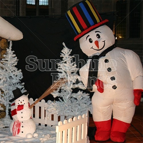 Snowman Walkabout Character Hire posing outside during a Christmas themed event.