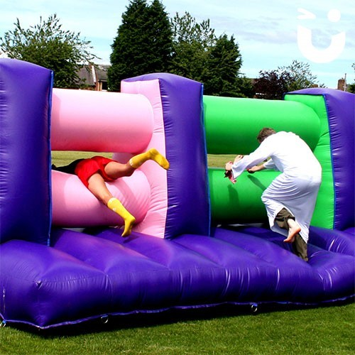 people iin fancy dress on our Assault Course Mangle during a team building event