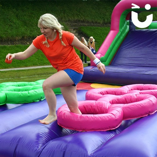 women running on the Assault Course Tyres