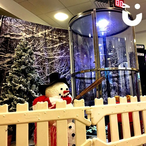 Our Christmas Cash Grabber Hire infront of a snowman for to add extra Christmas atmosphere