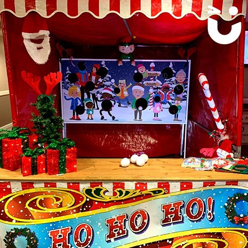 The Snowball Toss Stall will test your skills as you try and get the balls in the holes