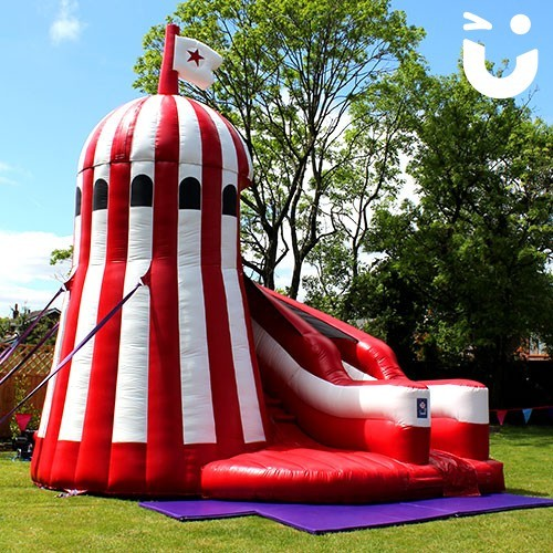 Our Helter Skelter Slide Hire set up in the sun for a family fun day outdoors