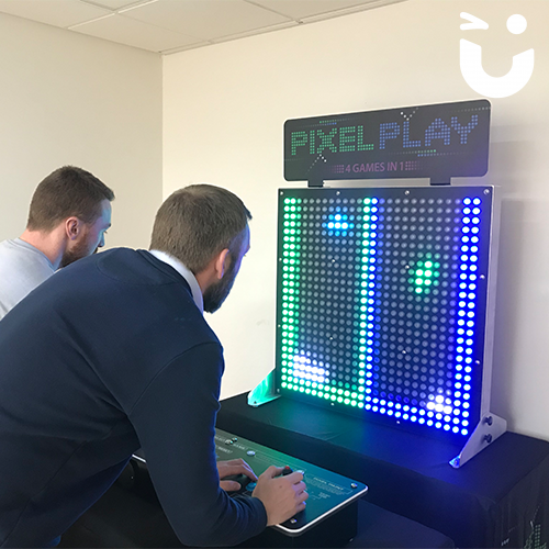 2 men playing on the Pixel Play Hire inside their offices