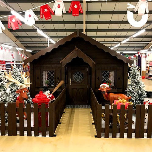 Santa's Wooden Grotto inside a clothing store