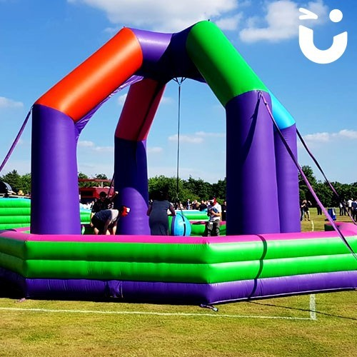 Inflatable Wrecking Ball providing fun for guests of an outdoor family fun day event, on hire from Sunshine Events.